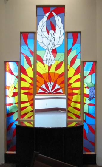 These 5 windows were done for a church in Grande Prairie.  The panels are set within an interior wall with the tabernacle set in the center.