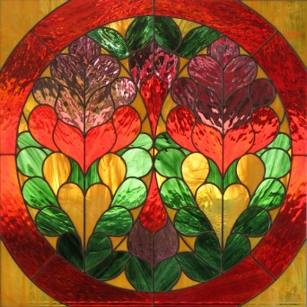 This panel was created for an interior opening. It is a memento of a trip and was designed from the wood work around an amazing rose window.