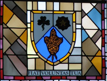 This window panel already existed.  We painted a crest and writing and then had to disassemble and cut into the panel to insert the crest. To add to the excitement the window was located 40 feet above the alter.