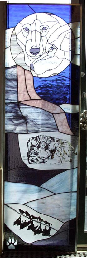 """""""Wolves"""" sidelight combined copper foil, lead came, and sandblasting. This panel quickly became a favorite of ours due to our small obsession with canines."""